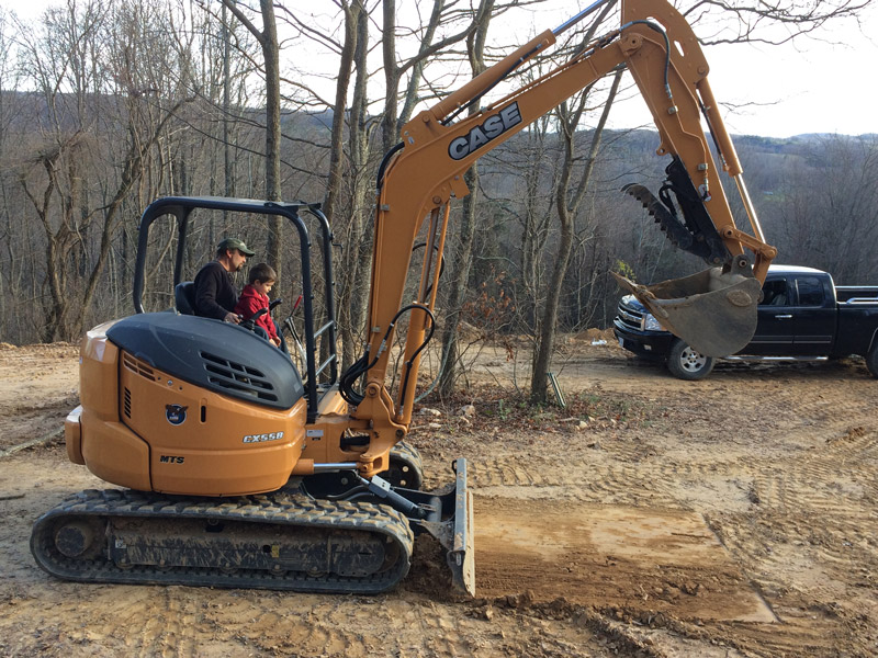 Michael and Bodhi on the excavator